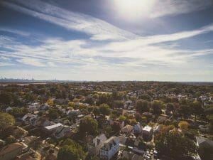 Picture of sun shining over city for Real Estate News for Investors Podcast Episode #722