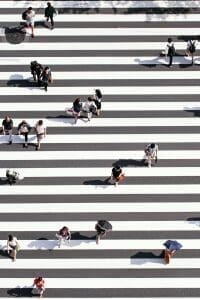 Picture of people in street crossing for Real Wealth Show Podcast Episode #677