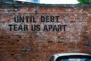 "Picture of ""Until Debt Tear Us Apart"" Graffiti for Real Wealth Show Podcast Episode #692"